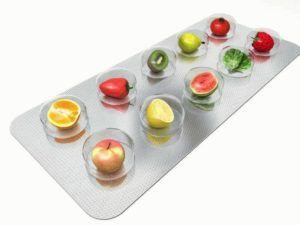 illustratie van fruitsoorten als tabletten in een plastic verpakking