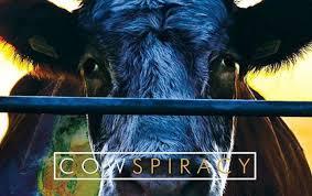 poster van cowspiracy met een koe achter het hek