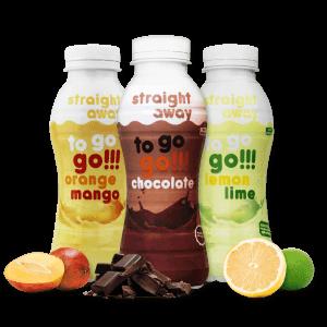 verschillende smaken straight away flesjes met mango, chocolade en limoen op de voorgrond